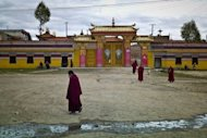 Buddhist monks are pictured outside a monastary in the town of Aba in China's Sichuan province. An 18-year-old nun in Aba set herself on fire and later died, rights groups said Sunday, the latest in a spate of such incidents among ethnic Tibetans protesting Beijing's rule