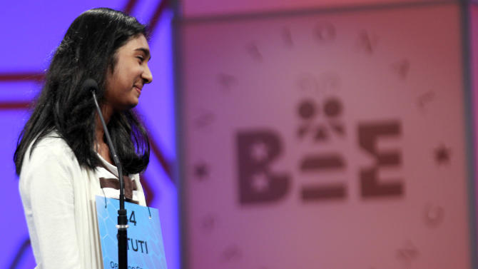 Stuti Mishra, 14, of West Melbourne, Fla., reacts after spelling a word during the finals of the National Spelling Bee Thursday, May 31, 2012 in Oxon Hill, Md. (AP Photo/Alex Brandon)