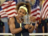 Serena Williams of the US poses with the trophy after defeating Victoria Azarenka of Belarus 6-2, 2-6, 7-5 in the 2012 US Open women's singles final at the USTA Billie Jean King National Tennis Center in New York