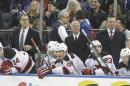 New Jersey Devils General Manager Lou Lamoriello, center, Adam Oates, right, and Scott Stevens, left, watch their team play during the first period of an NHL hockey game against the New York Rangers, Saturday, Dec. 27, 2014, in New York. (AP Photo/Frank Franklin II)