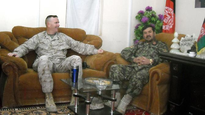 In this photo taken March 25, 2013, U.S. Marine Lt. Col. Philip Treglia and Afghan Army Brig. Gen. Mohammad Ali Sujai, right, drink tea during one of their near-daily meetings at the Afghan National Army's 1st Brigade 215th Corps headquarters at Camp Garmser, Helmand province, Afghanistan. Treglia leads the U.S. Security Forces Advise and Assist Team to guide the Afghans as they transition to independent operations ahead of the December 2014 deadline for the draw down of most NATO troops. U.S. commanders, trying to hand off war-fighting responsibility by the end of 2014, are encouraged by the uneven yet steady progress of fledgling Afghan security forces. (AP Photo/Kim Dozier)