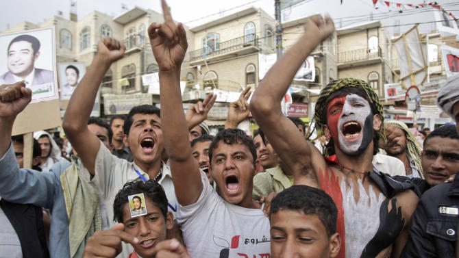 Anti-government protestors, shout slogans during a demonstration demanding the resignation of Yemeni President Ali Abdullah Saleh, in Sanaa, Yemen, Thursday, June 30, 2011. Yemen's president, hospitalized in Saudi Arabia after an attack nearly a month ago on his palace, has instructed his deputy to hold talks with political opponents on a deal to transfer power and end the nation's spiraling political crisis, his foreign minister said Wednesday. (AP Photo/Hani Mohammed)