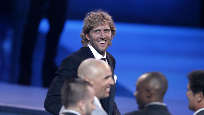 Dallas Mavericks Dirk Nowitzki and teammates accept the award for Best Team at the ESPY Awards on Wednesday, July 13, 2011, in Los Angeles. (AP Photo/Matt Sayles)