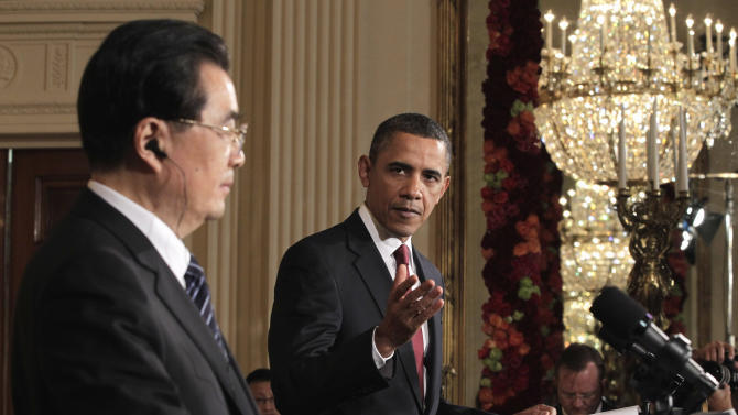 President Barack Obama gestures during his joint news conference with China's President Hu Jintao, Wednesday, Jan. 19, 2011, in the East Room of the White House in Washington. (AP Photo/J. Scott Applewhite)
