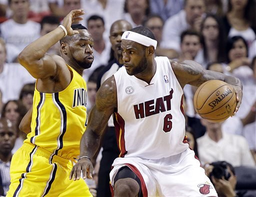 Indiana Pacers forward Sam Young (4) defends Miami Heat forward LeBron James (6) during the first half of Game 2 in their NBA basketball Eastern Conference finals playoff series, Friday, May 24, 2013,