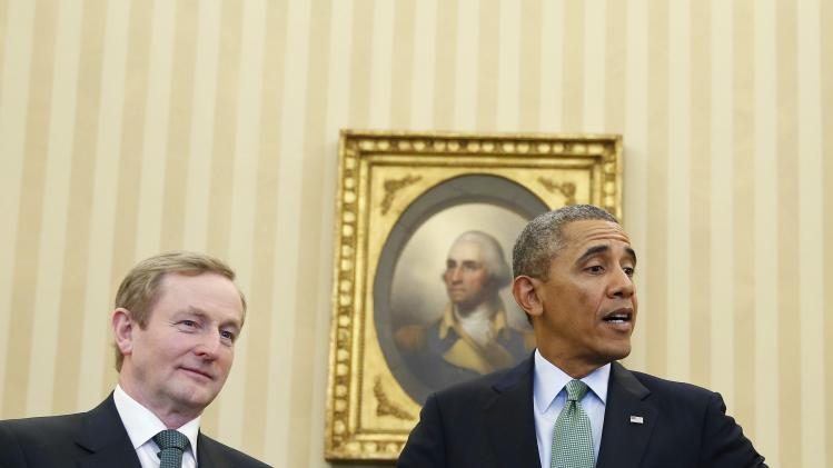 U.S. President Obama and Irish PM Kenny stand in the Oval Office of the White House in Washington