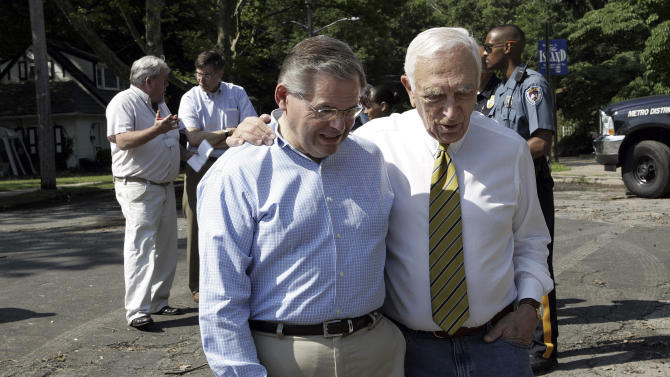 RETRANSMISSION TO CORRECT SPELLING FROM LATENBURG TO LAUTENBERG - FILE - In this Friday, June 30, 2006 file photograph, Sens. Robert Menendez, D-N.J., left, and Frank Lautenberg, D-N.J., talk as they walk together before touring some of the flooded neighborhoods in Trenton, N.J. Sen. Robert Menendez, whose political career began in a place with a reputation as one of the most corrupt corners of the nation, has often found himself the focus of ethics allegations as he has risen to prominence. (AP Photo/Mel Evans, File)