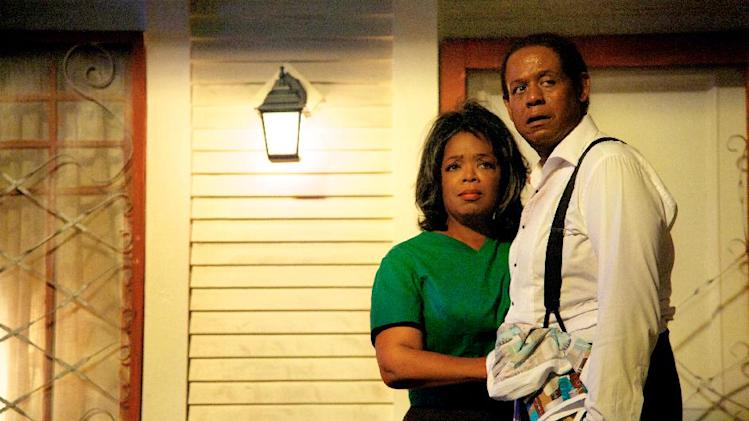 "This film image released by The Weinstein Company shows Oprah Winfrey as Gloria Gaines, left, and Forest Whitaker as Cecil Gaines in a scene from ""Lee Daniels' The Butler."" When ""Lee Daniels' The Butler,"" Winfrey's first feature since ""Beloved,"" hit No. 1 in its debut last weekend, she brought out a purple Hula Hoop she uses for special occasions. (AP Photo/The Weinstein Company, Anne Marie Fox, File)"