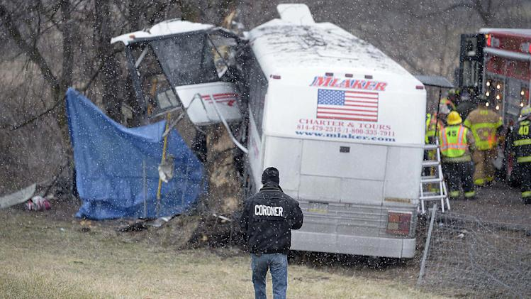 Members of the Cumberland County Coroners Office investigate the scene of a tour bus crash on the Pennsylvania Turnpike on Saturday, March 16, 2013 near Carlisle, Pa.  Authorities say the tour bus crashed on the freeway at mile marker 227 in central Pennsylvania, and serious injuries have been reported.  Lacrosse players from Seton Hill University and three coaches were among the 23 people aboard when the bus crashed at about 9 a.m., turnpike spokeswoman Renee Colborn said. It's not clear what caused the crash, but state police were investigating, said Megan Silverstram of the Cumberland County public safety department. (AP Photo/The Sentinel, Jason Malmont ) MANDATORY CREDIT
