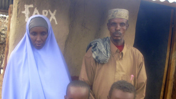 This July 28, 2011 photo shows Somali refugee Ahmedhashim Mawlid Abdi with his family in Dagahaley camp in Dadaab, Kenya. Famine and violence in Somalia pushed Abdi, a 40-year-old father of seven, to flee his country. On his way to the world's largest refugee camp in Kenya, his pregnant wife was raped in his presence and he lost a 7-year-old son to hunger, disease and exhaustion. (AP Photo/Malkhadir Muhumed)