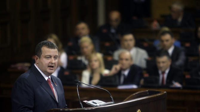 Serbia's prime minister designate, Ivica Dacic, front, speaks to members of the parliament in Belgrade, Serbia, Thursday, July 26, 2012. Dacic, the wartime spokesman of late strongman Slobodan Milosevic, who has shifted away from the former patron but has also kept some of his trademark features, is set to become Serbia's new prime minister on Thursday, triggering unease despite his proclaimed pro-EU policies. (AP Photo/ Marko Drobnjakovic)