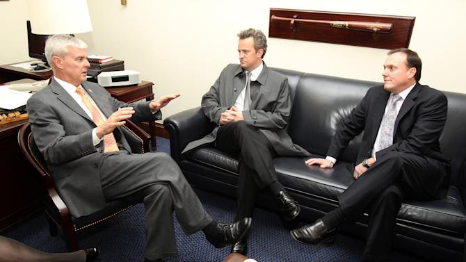 IMAGE DISTRIBUTED FOR NATIONAL ASSOCIATION OF DRUG COURT PROFESSIONALS - National Association of Drug Court Professionals 'All Rise Ambassador' Actor Matthew Perry, center, and CEO West Huddleston, right, discuss funding for Drug Courts and Veterans Treatment Courts with Congressman Steve Womack (R-AR) on Thursday, March 21, 2013 in Washington, DC. (Paul Morigi / AP Images for National Association of Drug Court Professionals)