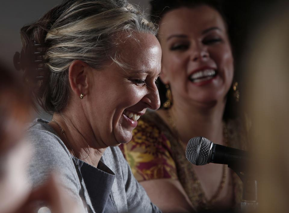 "Celebrity chef Gabrielle Hamilton, left, and actress/food blogger Debi Mazar laugh during a panel discussion called ""Girls Gone Wild"" about women in the celebrity cooking world at the South Beach Wine and Food Festival, Saturday, Feb. 25, 2012 in Miami.  (AP Photo/Carlo Allegri)"