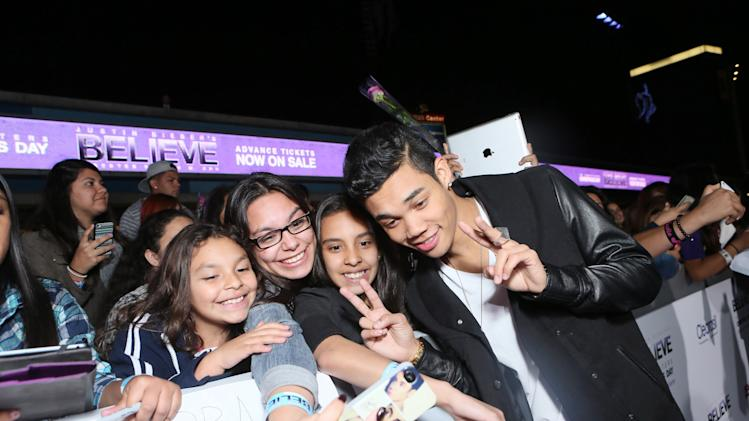 "Roshon Fegan seen at the World Premiere of Open Road's ""Justin Bieber's Believe"" presented by Teen Vogue and sponsored by Clearasil, on Wednesday, Dec. 18, 2013 in Los Angeles. (Photo by Alexandra Wyman/Invision for Open Road Films/AP Images)"