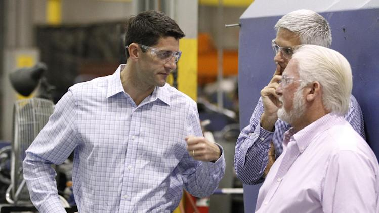 Paul Ryan, R-Wis., left, talks with Piedmont Precision Machine Company ...