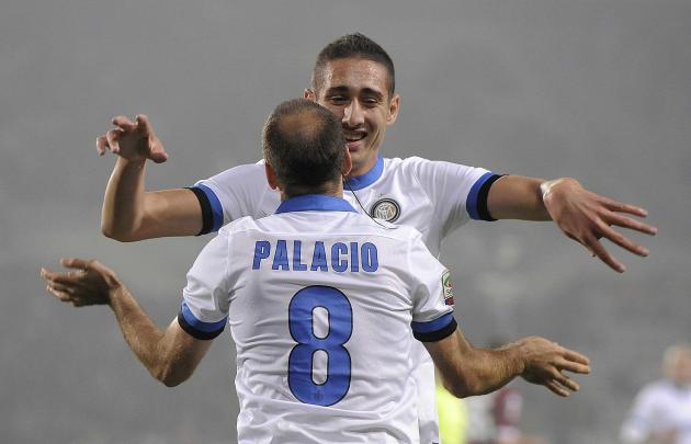 Inter Milan's Palacio celebrates with his teammate Belfodil after scoring his second goal against Torino during their Italian Serie A soccer match in Turin