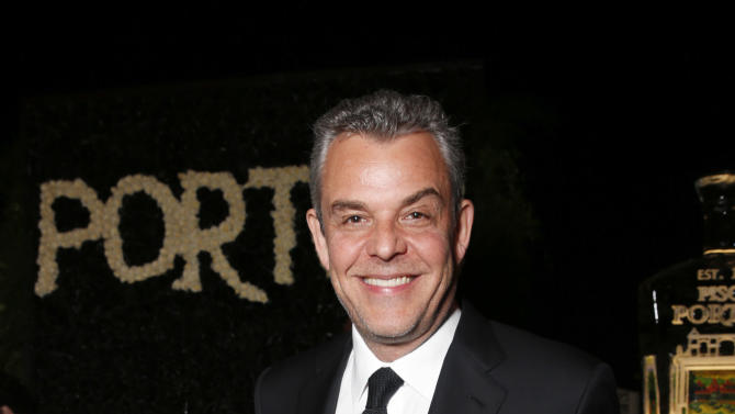 IMAGE DISTRIBUTED FOR PORTON - Danny Huston salutes legend of art and fashion Mario Testino at his Peruvian Natives' Exhibition Presented by Porton at Prism on  Saturday February 23, 2013 in Los Angeles. (Photo by Todd Williamson/Invision for Porton/AP)
