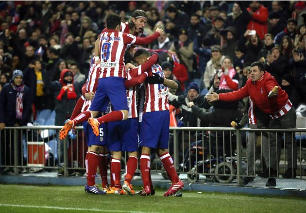 Atletico Madrid players celebrate Diego Costa's goal against Levante during their Spanish first division soccer match in Madrid