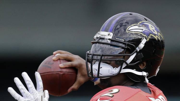 In this Jan. 30, 2013 photo, Baltimore Ravens quarterback Tyrod Taylor warms up during an NFL Super Bowl XLVII football practice in New Orleans. The Ravens face the San Francisco 49ers in Super Bowl XLVII on Sunday, Feb. 3. (AP Photo/Patrick Semansky)