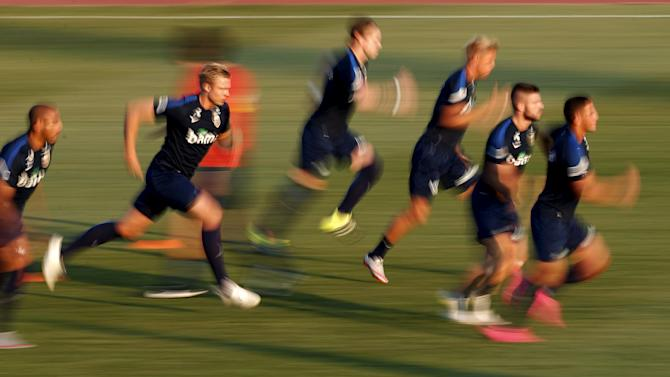 Norway's national soccer team warms up during a training session at Vassil Levski stadium in Sofia