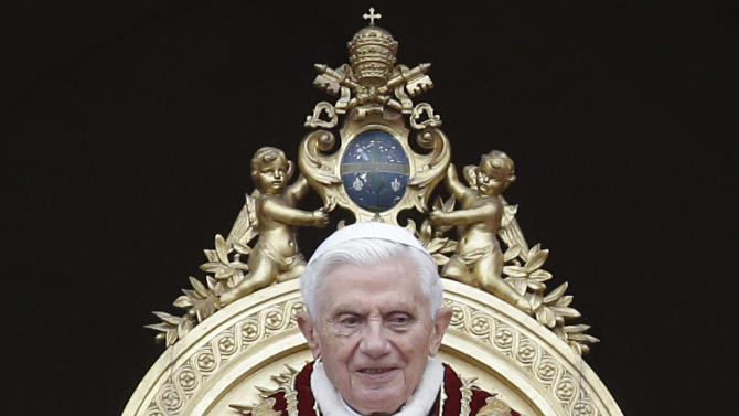 "Pope Benedict XVI delivers his ""Urbi et Orbi"" (to the City and to the World) speech from the central loggia of St. Peter's Basilica, at the Vatican, Tuesday, Dec. 25, 2012. Pope Benedict XVI has wished Christmas peace to the world, decrying the slaughter of the ""defenseless"" in Syria and urging Israelis and Palestinians to find the courage to negotiate. Delivering the Vatican's traditional Christmas day message from the central balcony of St. Peter's Basilica, a weary-looking and hoarse-sounding Benedict on Tuesday also encouraged Arab spring nations, especially Egypt, to build just and respectful societies. (AP Photo/Gregorio Borgia)"