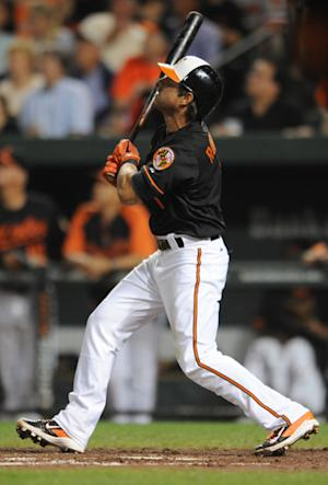 Roberts hits slam as Orioles beat Athletics 9-7