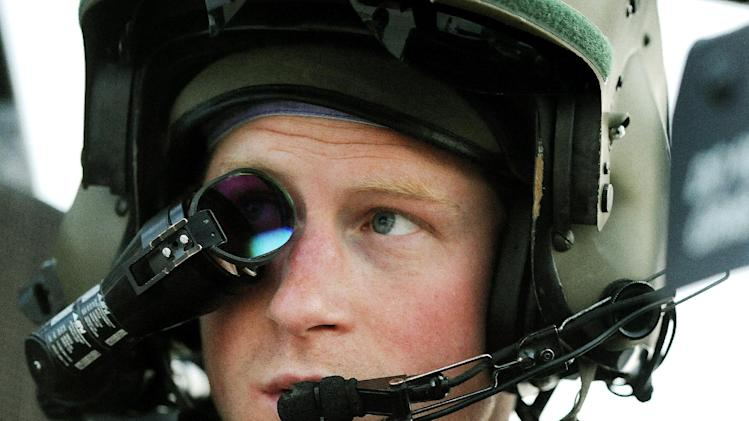 In this photo taken Dec. 12, 2012 and made available Monday Jan. 21, 2013 Britain's Prince Harry or just plain Captain Wales as he is known in the British Army, wears his monocle gun sight as he sits in the front seat of his cockpit at the British controlled flight-line in Camp Bastion southern Afghanistan. The Ministry of Defense announced Monday that the 28-year-old prince is returning from a 20-week deployment in Afghanistan, where he served as an Apache helicopter pilot with the Army Air Corps.  (AP Photo/ John Stillwell, Pool)