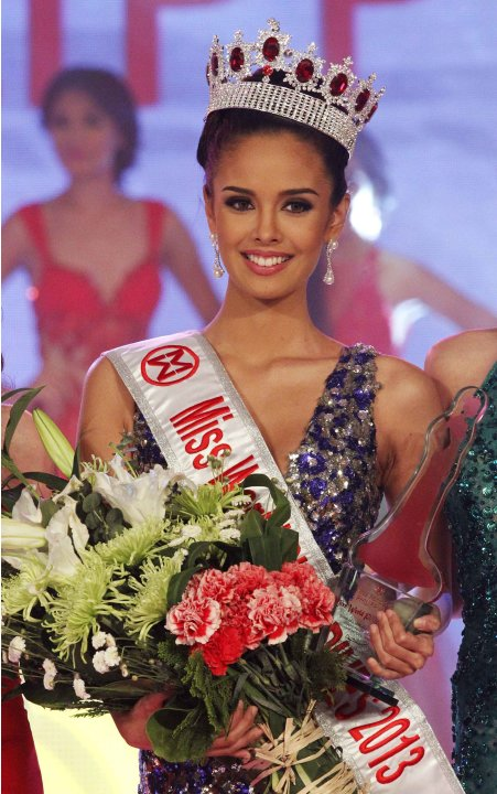 Megan Young, a local actress, poses for photographers after being crowned as the Miss World Philippines 2013 during the pageant coronation night in Manila
