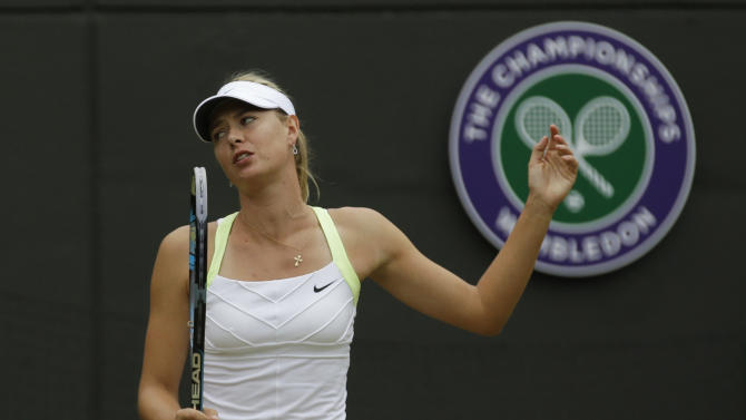Maria Sharapova of Russia reacts during a fourth round singles match against Sabine Lisicki of Germany at the All England Lawn Tennis Championships at Wimbledon, England, Monday, July 2, 2012. (AP Photo/Sang Tan)