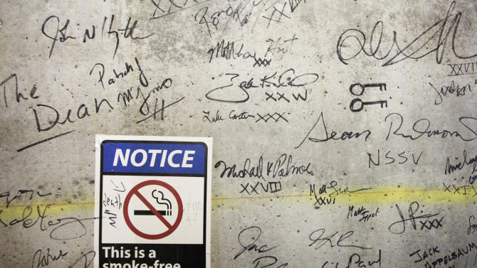 In this Jan. 15, 2013 photo, autographs cover a wall on a top floor of One World Trade Center in New York. Construction workers finishing New York's tallest building at the World Trade Center are leaving their personal marks on the concrete and steel in the form of graffiti. (AP Photo/Mark Lennihan)