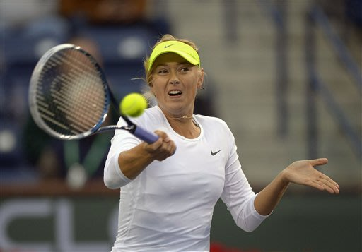 Maria Sharapova, of Russia, returns a shot to Francesca Schiavone, of Italy, during their match at the BNP Paribas Open tennis tournament on Friday, March 8, 2013, in Indian Wells, Calif