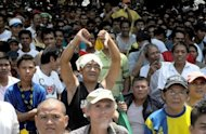 "A fan in Manila give a thumbs down to protest US Timothy Bradley's victory over Filipino boxing superstar Manny Pacquiao as they watched the WBO welterweight title match on a giant outdoor screen. Shocked Filipinos claimed ""highway robbery"" Sunday after boxing superstar Pacquiao was stunned by Bradley, losing his first bout in seven years"