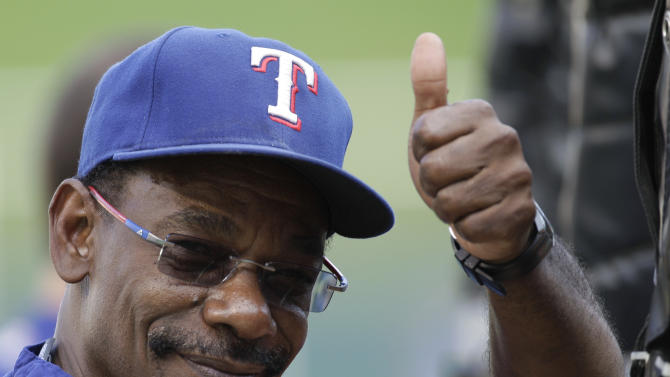 Texas Rangers manager Ron Washington gives a thumbs up before Game 4 of baseball's World Series against the St. Louis Cardinals Sunday, Oct. 23, 2011, in Arlington, Texas. (AP Photo/Paul Sancya)