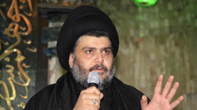 Firebrand Shiite cleric Muqtada al-Sadr addresses worshippers during the Friday prayers at Abdul-Qadir al-Gailani Sunni mosque in Baghdad, Iraq, Friday, Jan. 4, 2013. Al-Sadr paid a visit Friday to a Baghdad church that was the scene of a deadly 2010 attack as well as one of the Iraqi capital's main Sunni mosques, an apparent overture to other religious groups as opposition mounts against his rival, Prime Minister Nouri al-Maliki. (AP Photo/ Karim Kadim)