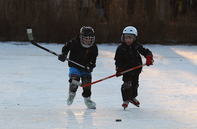HAMBURG, GERMANY - FEBRUARY 10: kids play ice hockey on the frozen Aussenalster river during the &#39;Alstervergnuegen&#39; on February 10, 2012 in Hamburg, Germany. The very popular annual city festival &#39;Alstervergnuegen&#39; takes place around the Alster lake in Hamburg. Last time the Alster was official approved for the &#39;Alstervergnuegen&#39; is 15 years ago.  (Photo by Joern Pollex/Getty Images)