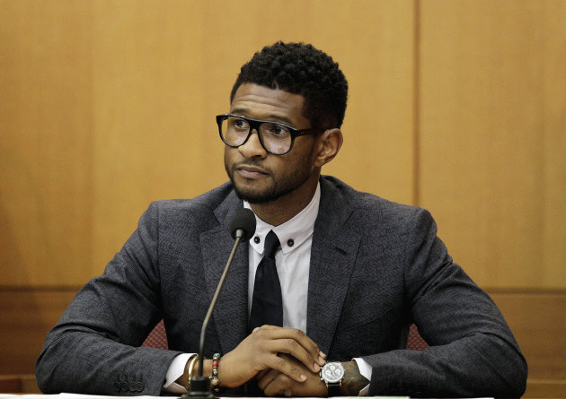 FILE - In this May 22, 2012 file photo, hip-hop artist Usher Raymond takes the witness stand in court in a legal battle with his ex-wife in a custody fight involving their two sons, in Atlanta. Fulton County Court Clerk's office spokeswoman Cherrise Boone says a judge ruled Friday, Aug. 24, 2012 that the 33-year-old singer will have primary physical custody of Usher Raymond V and Naviyd Ely Raymond. (AP Photo/David Goldman, File)