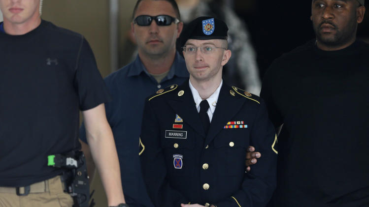Army Pfc. Bradley Manning is escorted out of a courthouse in Fort Meade, Md., Tuesday, July 30, 2013, after receiving a verdict in his court martial. The successful prosecution of Army Pfc. Bradley Manning gives a boost to the Obama administration's aggressive pursuit of people it believes have leaked national security secrets to the media. Manning was acquitted Tuesday of the most serious charge he faced, of aiding the enemy, but he was found guilty by a military judge of enough charges to send him to prison for many years, and perhaps the rest of his life. (AP Photo/Patrick Semansky)