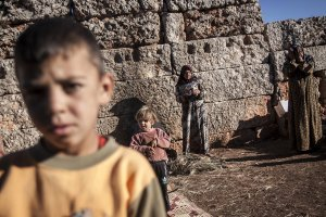 In this Friday, Sept. 27, 2013 photo, displaced Syrian…