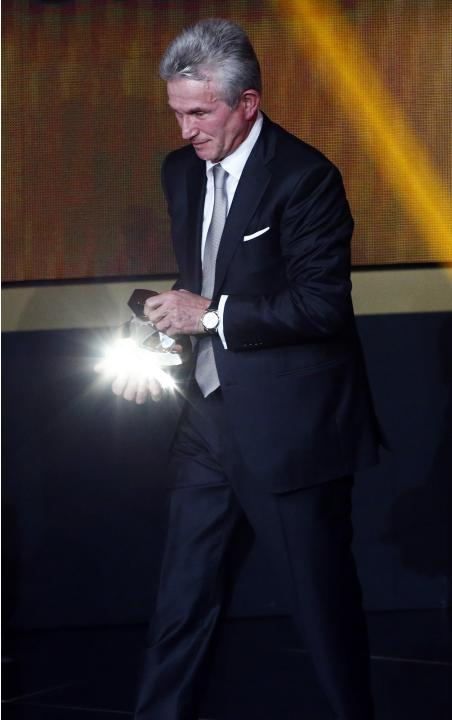 Former Bayern Munich coach Jupp Heynckes holds his trophy after winning the FIFA Coach of the Year award during the FIFA Ballon d'Or soccer awards ceremony in Zurich