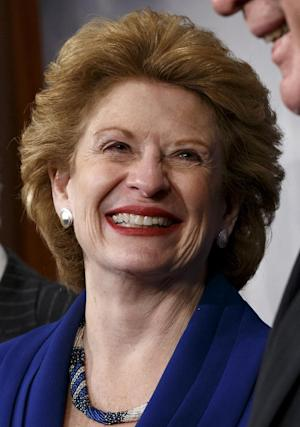 FILE - In this Feb 4, 2014 file photo, Senate Agriculture Committee Chair Sen. Debbie Stabenow, D-Mich., is seen during a news conference on Capitol Hill in Washington, Tuesday, Feb. 4, 2014, after Congress gave its final approval to a sweeping five-year farm bill. When President Barack Obama comes to East Lansing on Friday to sign the Farm Bill, it will put attention on how research schools such as Michigan State University will be one of the big beneficiaries of the nearly $100 billion-a-year measure — even if the millions it represents is comparatively small. And scientists are breathing a sigh of relief that funding will continue flowing, along with money for new efforts, after years of political wrangling. (AP Photo/J. Scott Applewhite)