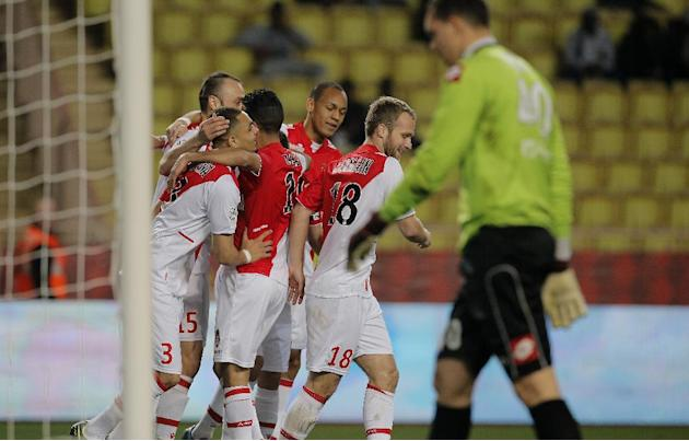 Monaco's team celebrate in font of Sochaux goalkeeper Yohann Pele, right, after Monaco's Dimitar Berbatov, left, scored the first goal against Sochaux during their French League One soccer mat