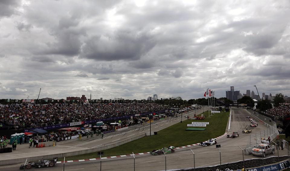 Drivers race during the IndyCar Detroit Grand Prix auto race on Belle Isle in Detroit, Sunday, June 2, 2013. (AP Photo/Paul Sancya)