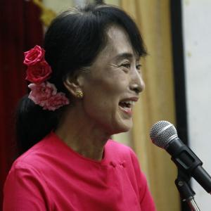 """Myanmar opposition leader Aung San Suu Kyi laughs as she talks to the media during a press conference at the headquarters of her National League for Democracy party in Yangon, Wednesday, June 6, 2012. A state-run newspaper called Suu Kyi and President Thein Sein """"the hope of Myanmar"""" - rare praise for the opposition leader that was tempered with worry that possible tensions between the two reform-minded politicians could derail changes in the long-oppressed country. (AP Photo/Khin Maung Win)"""