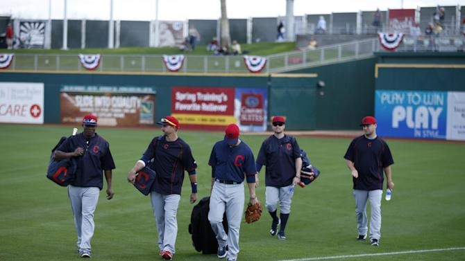 Cleveland Indians players arrive before a spring training exhibition baseball game against the Cincinnati Reds, Tuesday, March 3, 2015, in Goodyear, Ariz. (AP Photo/John Locher)