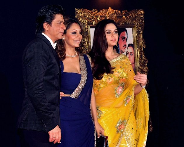 (L-R)  Indian Bollywood film actor Shahrukh Khan, his wife Gauri Khan and actress Preity Zinta pose on the red carpet at the premiere of the Hindi film 'Jab Tak Hai Jaan' in Mumbai on November 12, 201
