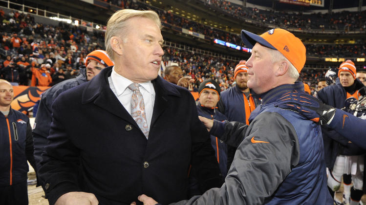 Denver Broncos executive vice president of football operations John Elway turns to hug head coach John Fox near the end of an NFL football game against the Kansas City Chiefs, Sunday, Dec. 30, 2012, in Denver. Denver won 38-3. (AP Photo/Jack Dempsey)