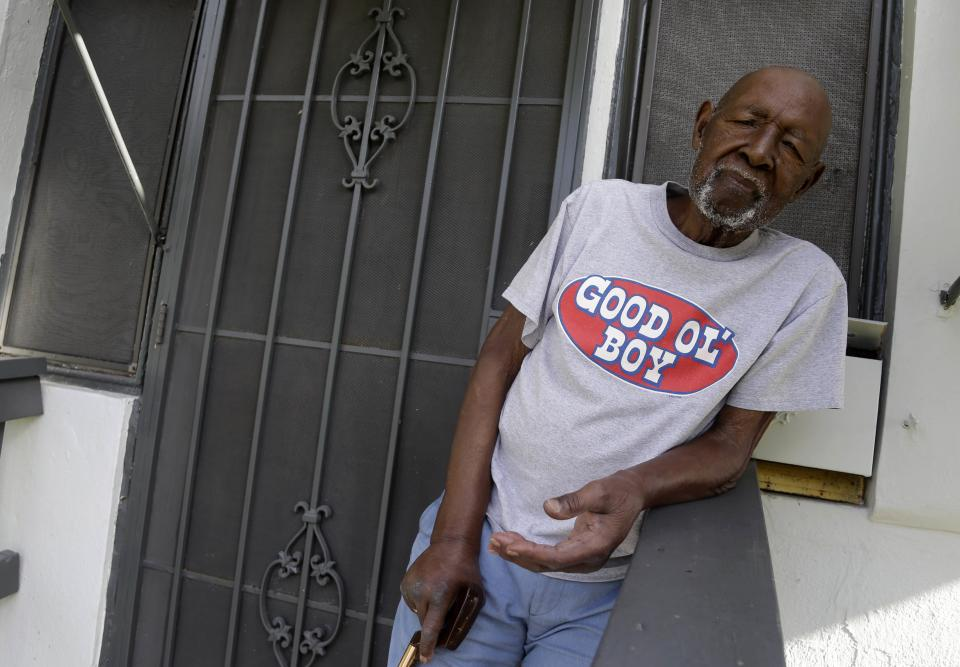 In this Thursday, Aug. 8, 2013 photo, James Poitier, 98, relaxes on the front porch of his home where he has lived since 1926, in the Village West neighborhood of Coconut Grove in Miami. Poitier's family immigrated from the Bahamas. (AP Photo/Lynne Sladky)