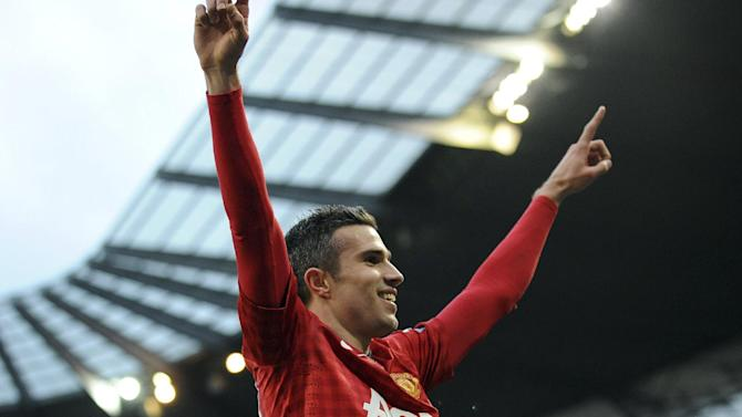 Manchester United's Robin Van Persie celebrates after he scores the third and winning goal of the game for his side during their Premier League soccer match against Manchester City at the Etihad Stadium in Manchester, England, Sunday Dec. 9, 2012. (AP Photo/Clint Hughes)