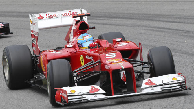 Ferrari driver Fernando Alonso of Spain steers his car during free practice at the Interlagos race track in Sao Paulo, Brazil,  Saturday, Nov. 24, 2012. Brazil's Formula One Grand Prix will take place Sunday. (AP Photo/Andre Penner)