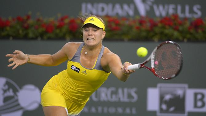 Angelique Kerber, of Germany, returns a shot to Caroline Wozniacki, of Denmark, during their match at the BNP Paribas Open tennis tournament, Friday, March 15, 2013, in Indian Wells, Calif. (AP Photo/Mark J. Terrill)
